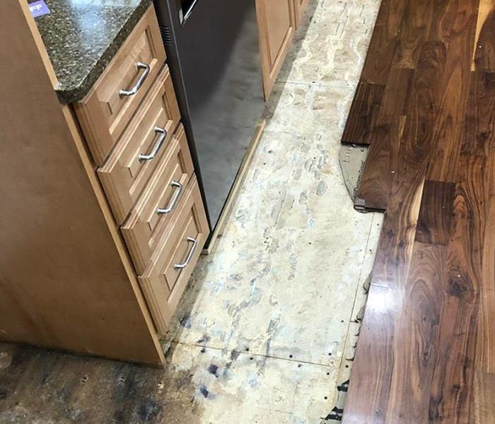 Water Damage in Kitchen Before